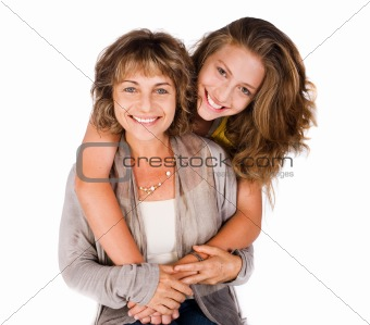 Pretty daughter hugging her mom from back