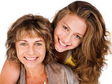 Close-up of smiling elder mum and daughter