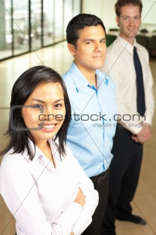 Asian Female Team Leader Row of Coworkers