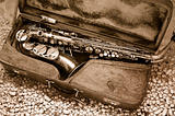 Saxophone in old leather case - still life