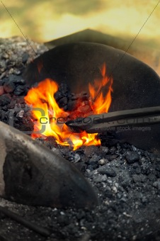 Blacksmith heating up iron - detail