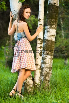 Girl in a birch grove