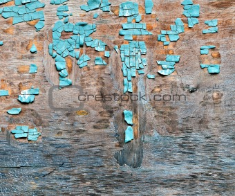 old blue flaky paint on a plywood background