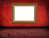 old  elegant golden frame on red plaster rough background