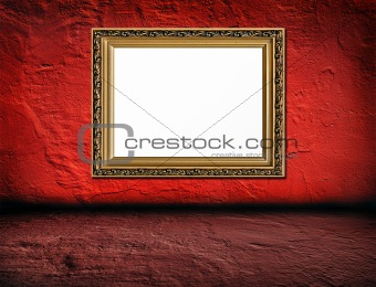old  elegant golden frame on red plaster rough background