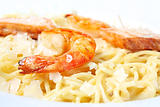 Pasta with salmon and tiger shrimps