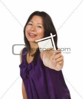 Attractive Multiethnic Woman Holding Small Blank Real Estate Sign in Hand Isolated on White Background Ready for Your Own Message.