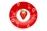 Deliciously half a red strawberry romantic plate