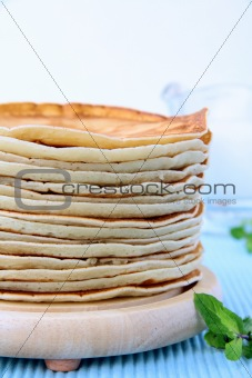 traditional American pancakes on a wooden stand