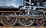wheels of an old steam locomotive standing on rail