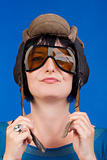 woman with an old army tank personal helmet- isolated on blue