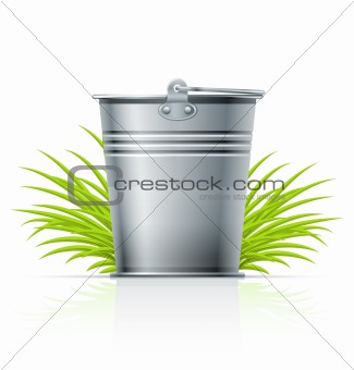 metallic bucket in grass