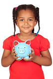African little girl with a blue piggy-bank