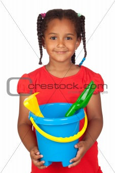 African little girl with beach toys