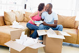 Couple unpacking boxes in new home kissing and smiling