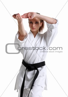 Karate. Young girl in a kimono