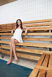 Pretty Caucasian woman sitting on a bench