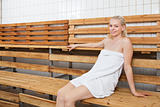 Young blond woman relaxing in sauna