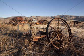 Old rustic farm equipment -- metal mechanical industrial worn wheel