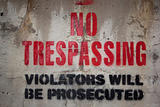 No trespassing on a cement wall