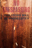 No trespassing on a wood wall