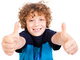 Smiling cute little boy gesturing thumbs up