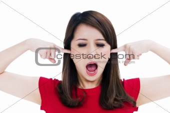 Frustrated young woman with fingers in her ears