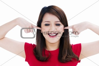 Happy young woman with fingers in her ears