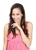 Happy young woman with her finger over her mouth