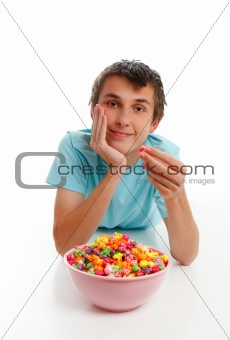 Boy relaxing with bowl popcorn