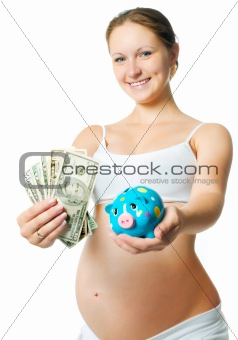 pregnant woman with a piggy bank