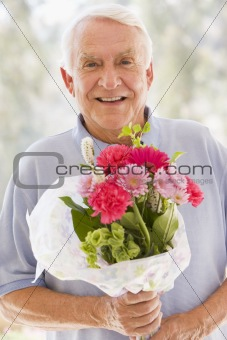 Man holding flowers and smiling