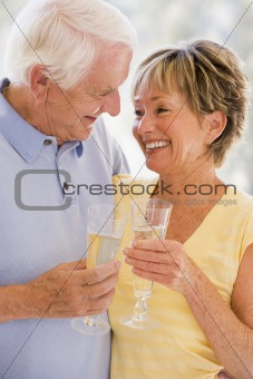 Couple drinking champagne and smiling