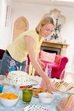 Woman at party setting out food and smiling