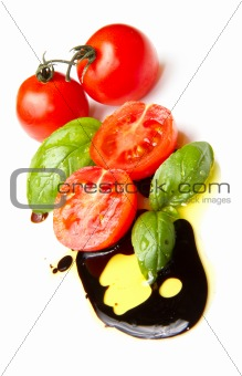 Fresh tomato and basil over olive oil and balsamic vinegar