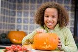 Young girl on Halloween with jack o lantern smiling