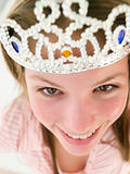 Teenage girl wearing crown and smiling