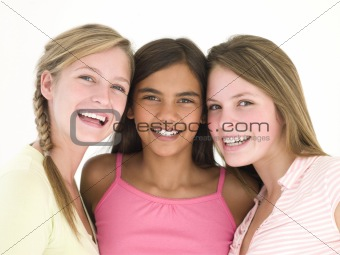 Three girl friends together smiling