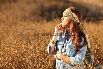 Beautiful Woman on a Field in Summertime