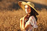 Young Beautiful Woman on a Field in Summer Time