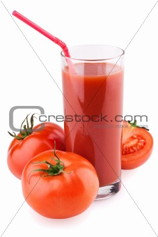 Full glass of fresh tomato juice with straw and tomatoes