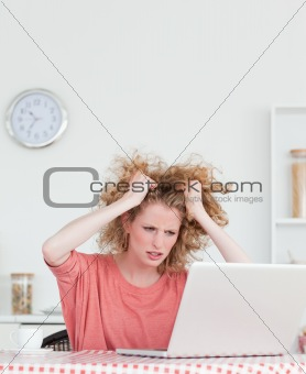 Attractive blonde female being angry while relaxing with her lap
