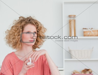 Attractive blonde woman drinking a cup of coffee while sitting i