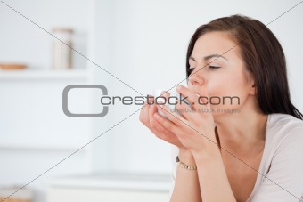 Close up of a brunette having a coffee