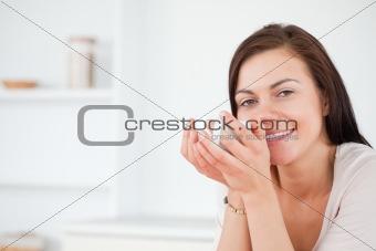 Close up of a brunette enjoying a coffee
