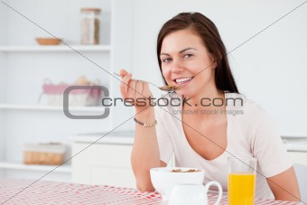 Beautiful woman eating her cereal