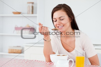 Charming woman eating cereal