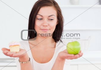 Cute woman with an apple and a piece of cake