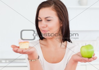 Charming woman with an apple and a piece of cake