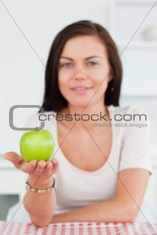 Cute woman showing an apple